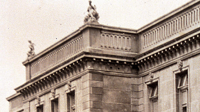 """This circa 1920s photo provided by The Preservation Society of Newport County shows footmen on the front stairs of The Elms, a mansion in Newport, R.I.  Newly discovered photographs, documents and family histories have inspired the creation of a tour about servants at The Elms, echoing themes of the British drama program, """"Downton Abbey."""" (AP Photo/The Preservation Society of Newport County)"""