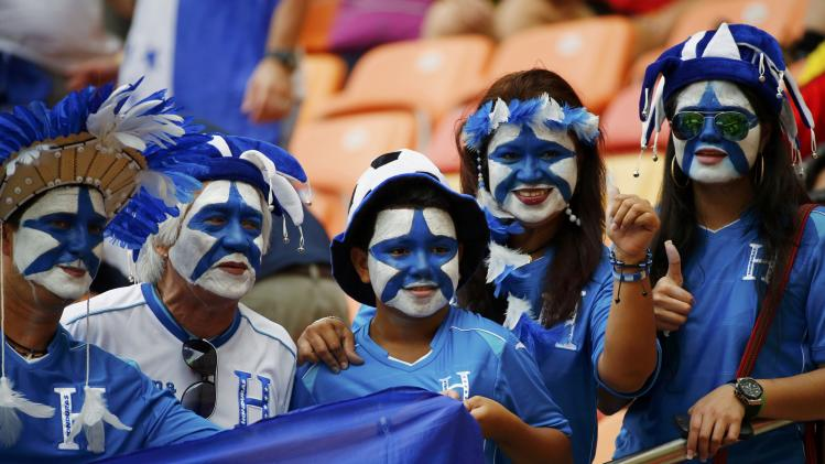Fans of Honduras wait for the start of their 2014 World Cup Group E soccer match against Switzerland at the Amazonia arena in Manaus