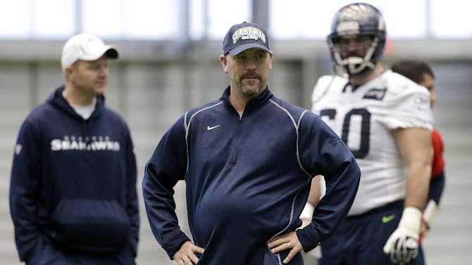 FILE - In this Jan. 10, 2013 file photo, Seattle Seahawks defensive coordinator Gus Bradley, center, stands on the field during NFL football practice in Renton, Wash. The Jacksonville Jaguars have hired Seattle defensive coordinator Gus Bradley as head coach. ESPN first reported the hire Thursday, Jan. 17, 2013. (AP Photo/Ted S. Warren, File)