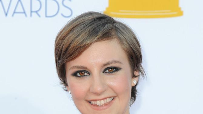 FILE - In this Sept. 23, 2012 file photo, actress Lena Dunham arrives at the 64th Primetime Emmy Awards at the Nokia Theatre in Los Angeles.  (Photo by Jordan Strauss/Invision/AP, File)