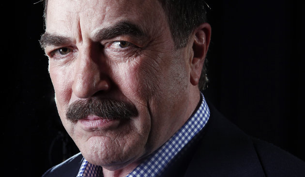 "In this March 21, 2012 photo, actor Tom Selleck poses for a portrait in New York. On the CBS hit drama, ""Blue Bloods,"" Selleck plays Frank Reagan, the NYPD Commissioner as well as the patriarch of a family devoted to law enforcement and one another. Selleck is also starring in ""Jesse Stone: Benefit of the Doubt,"" airing on CBS on May 20. It's the eighth in the series of Jesse Stone TV whodunits that began in 2005, based on characters created by the late Robert B. Parker in his best-selling series of books. (AP Photo/Carlo Allegri)"