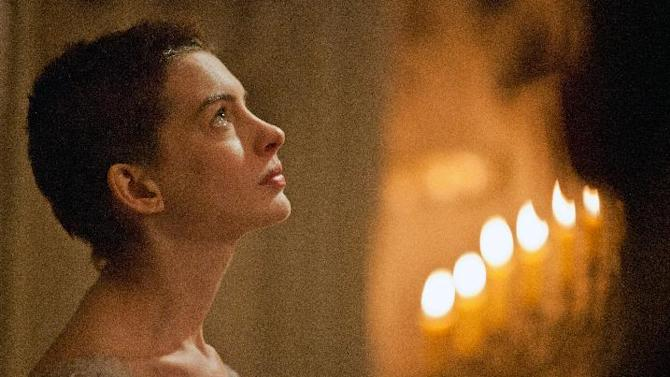 """FILE - This film image released by Universal Pictures shows actress Anne Hathaway portraying Fantine, a struggling, sickly mother forced into prostitution in 1800s Paris, in a scene from the screen adaptation of """"Les Miserables.""""  Hathaway is nominated for an Academy Award for supporting actress for """"Les Miserables."""" The 85th Academy Awards are held in Los Angeles on Sunday, Feb. 24. (AP Photo/Universal Pictures, Laurie Sparham, file)"""