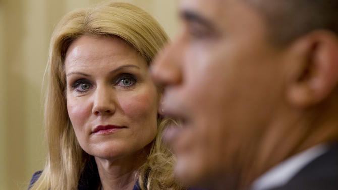 Denmark's Prime Minister Helle Thorning-Schmidt, left, looks on as President Barack Obama speaks in the Oval Office of the White House in Washington, Friday, Feb., 24, 2012. (AP Photo/Pablo Martinez Monsivais)