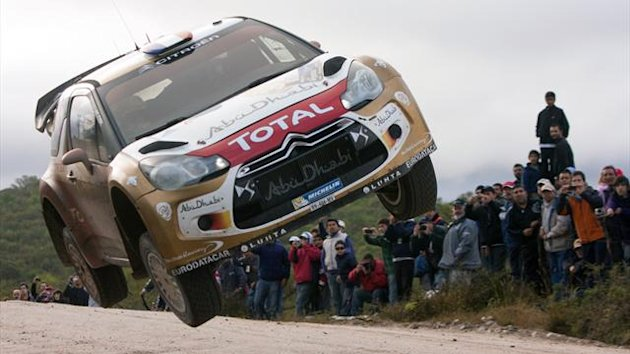 French driver Sebastien Loeb jumps with his Citroen DS3 WRC with his co-driver Daniel Elena from Monaco during the 6th stage of the WRC Argentina 2013 near Villa del Dique, Cordoba, Argentina (AFP)