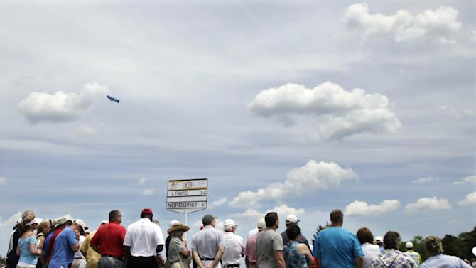 Fans watch as Stacy Lewis and Anna Nordqvist, of Sweden, play the third hole during the final round of the LPGA ShopRite Classic golf competition at Stockton Seaview Hotel and Golf Club in Galloway Township, N.J., Sunday, June 3, 2012. (AP Photo/Mel Evans)
