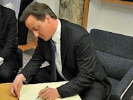 Cameron 'finds out about his own policies on the radio'