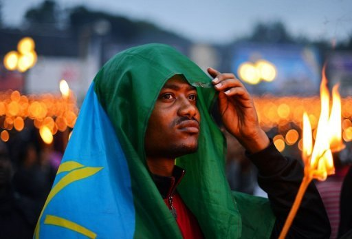 A man wearing an Ethiopian flag takes part in a candle lit vigil in Meskal square, Addis Ababa on August 31 for prime minister Meles Zenawi who died on August 20. His body is lying in state until his official funeral which will be on September 2