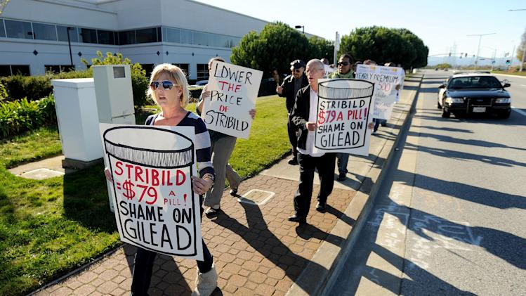 "About 40 protesters from across the country converged on Gilead Sciences headquarters in Foster City, Calif., on Wednesday, Nov. 14, 2012, calling on the drug maker to lower prices for its Stribild AIDS medication. Joined by an 18-wheel tractor trailer adorned with a ""Stop Corporate Welfare for Gilead"" sign, picketers marched through streets around the company's headquarters for about an hour. (Noah Berger /AP Images for AIDS Healthcare Foundation)"