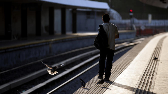 In this Jan. 28, 2013 photo, a man waits for the train at the Once train station in Buenos Aires, Argentina. Nearly a year after a train crash killed 51 people and injured 800 others on Feb. 22, 2012, exposing systemic corruption and other failures in Argentina's transportation systems, the victims' families and other passengers are as angry as ever over a litany of promised improvements and safety measures that have not been made. (AP Photo/Natacha Pisarenko)