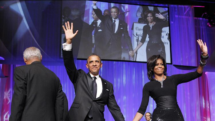 President Barack Obama and first lady Michelle Obama, wave to the crowd at the Congressional Black Caucus Foundation Foundation Annual Phoenix Awards in Washington Saturday Sept. 24, 2011. (AP Photo/Manuel Balce Ceneta)