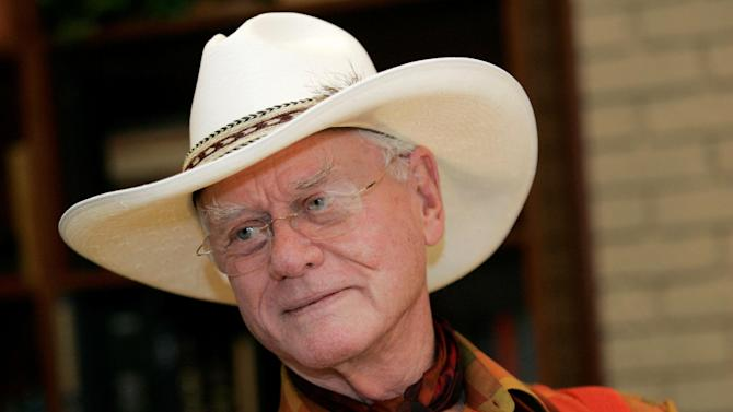 "FILE - In this Thursday, Oct. 9, 2008 photo, actor Larry Hagman listens to a reporter's question while visiting the Southfork Ranch in Parker, Texas, made famous in the television show ""Dallas."" Actor Larry Hagman, who for more than a decade played villainous patriarch JR Ewing in the TV soap Dallas, has died at the age of 81, his family said Saturday Nov. 24, 2012.  (AP Photo/Tony Gutierrez)"