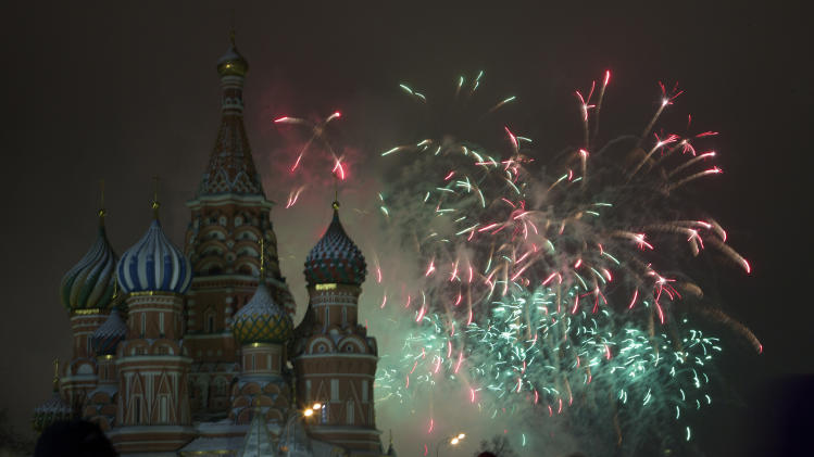 Fireworks explode in the sky over St. Basil Cathedral as Russians celebrate New Year on Red Square in Moscow, Russia, on Tuesday, Jan. 1, 2013. (AP Photo/Ivan Sekretarev)