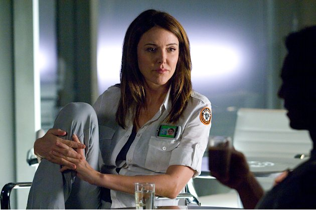"Christa Miller as Dr. Angela Noyce in A&E's original mini-series ""The Andromeda Strain."""