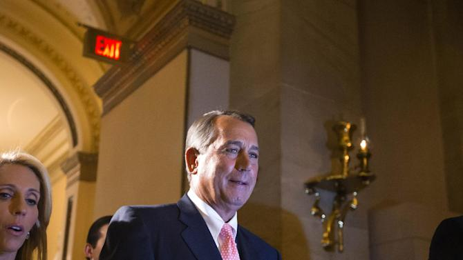 """Speaker of the House John Boehner, R-Ohio, returns to his office after a procedural vote on the House floor, at the Capitol in Washington, Monday, Sept. 30, 2013. The Republican-controlled House and the Democrat-controlled Senate are at an impasse as Congress continues to struggle over how to prevent a possible shutdown of the federal government when it runs out of money. President Barack Obama ramped up pressure on Republicans Monday to avoid a post-midnight government shutdown, saying that failure to pass a short-term spending measure to keep agencies operating would """"throw a wrench into the gears"""" of a recovering economy. (AP Photo/J. Scott Applewhite)"""