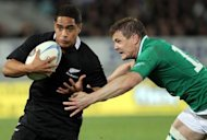 New Zealand All Blacks player Aaron Smith (left) gets past the tackle of Brian O'Driscoll of Ireland during their rugby union match at Eden Park in Auckland on June 9. The All Blacks beat Ireland 42-10