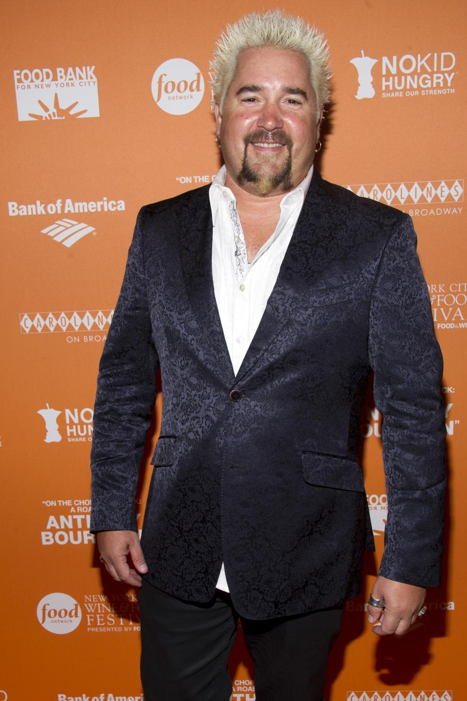 "Guy Fieri attends ""On The Chopping Block: A Roast of Anthony Bourdain"" on Thursday, Oct. 11, 2012 in New York. (Photo by Charles Sykes/Invision/AP Images)"