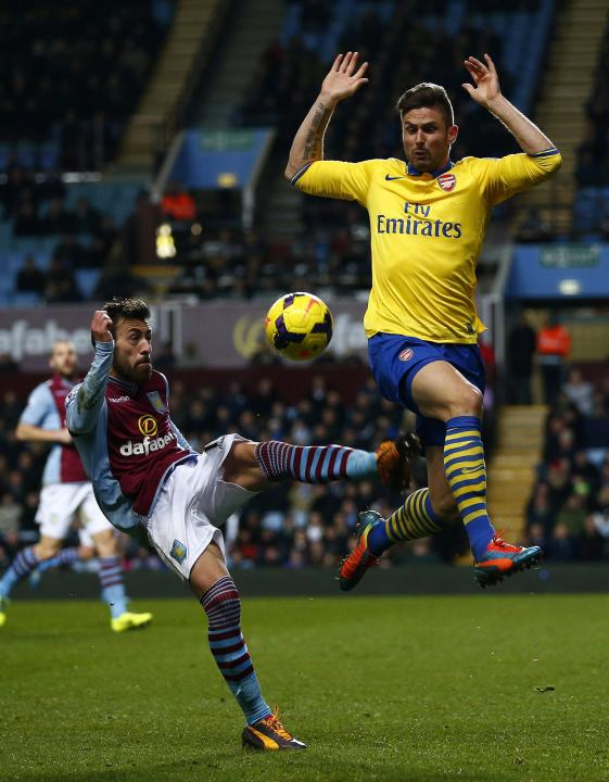 Aston Villa's Luna challenges Arsenal's Giroud during their English Premier League soccer match at Villa Park in Birmingham