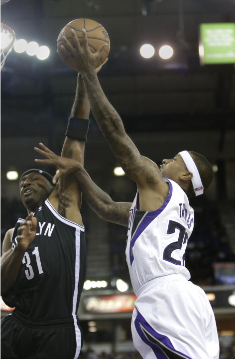 Sacramento Kings guard Isaiah Thomas, right, drives to the basket Brooklyn Nets guard Jason Terry, during the fourth   quarter of an NBA basketball game in Sacramento, Calif., Wednesday, Nov. 13, 2013