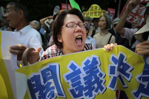 People protest outside the Japanese prime minister's…