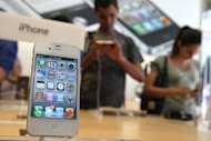 <p>File photo shows the Apple iPhone 4Gs displayed at an Apple store in 2011. Apple becomes the focus of the technology universe Wednesday as the world awaits a new iPhone with a big, beautiful touchscreen and connectivity to blazingly fast telecom networks.</p>