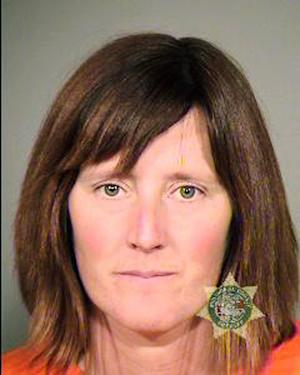 File- This undated file photo provided by the Multnomah County Sheriff's Office in Portland, Ore., shows Rebecca Rubin. Canadian citizen Rubin, 39, is expected to plead guilty in federal court Thursday, Oct. 10, 2013. Rubin faces charges of being a member of cells of the Earth Liberation Front and Animal Liberation Front known as The Family. Investigators blame the group based in Eugene for 20 fires across the West from 1996 to 2001 that did $40 million damage. (AP Photo/Multnomah County Sheriff's Office, file)