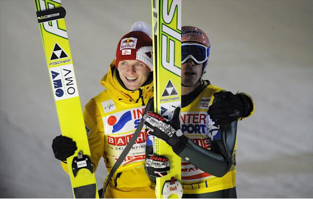Members of Austrian team Andreas Kofler and Thomas Morgenstern (R) celebrate after winning the Ski Jumping team competition event of the FIS World Cup Lahti Ski Games in Lahti on March 3, 2012.   AFP