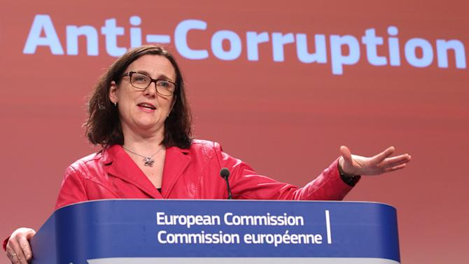 European Commissioner for Home Affairs Cecilia Malmstrom addresses the media, at the European Commission headquarters in Brussels, Monday, Feb. 3, 2014. Corruption affects all 28 member countries of the European Union and costs their economies around 120 billion euros a year, the EU's first report on corruption says. (AP Photo/Yves Logghe)