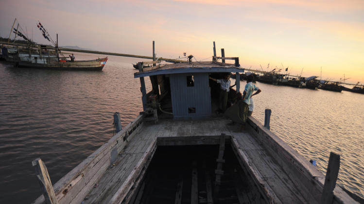In this Nov. 28, 2013 photo, a boat which was intended to carry fleeing Rohingya Muslims until doubts arose about its seaworthiness, is docked at a lagoon near the The' Chaung refugee camp on the outskirts of Sittwe, Myanmar. Although the United Nations considers the Rohingya to be among the most persecuted groups on earth, nearby countries easily reachable by boat have been implementing policies and practices to ensure that Rohingya refugees don't wash up on their shores. (AP Photo/Kaung Htet)