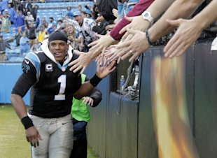 Cam Newton, man of the people. (AP Photo/Bob Leverone)
