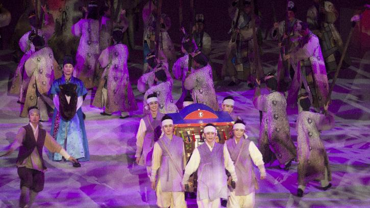 Actors during a traditional Korean performance which symbolizes people of the world joining in the celebration of a beautiful moment at the opening ceremony of the 2013 Special Olympics World Winter Games at the YongPyong dome in PyeongChang, South Korea on Tuesday, Jan. 29, 2013. (Manchul Kim/AP Images for Special Olympics)