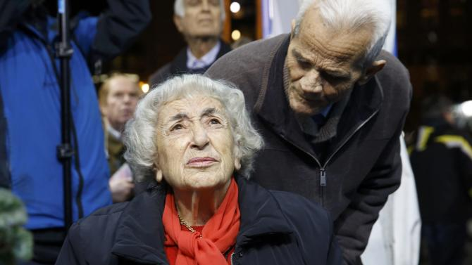 Supporters of Greece's New Democracy party react to exit poll results in Athens
