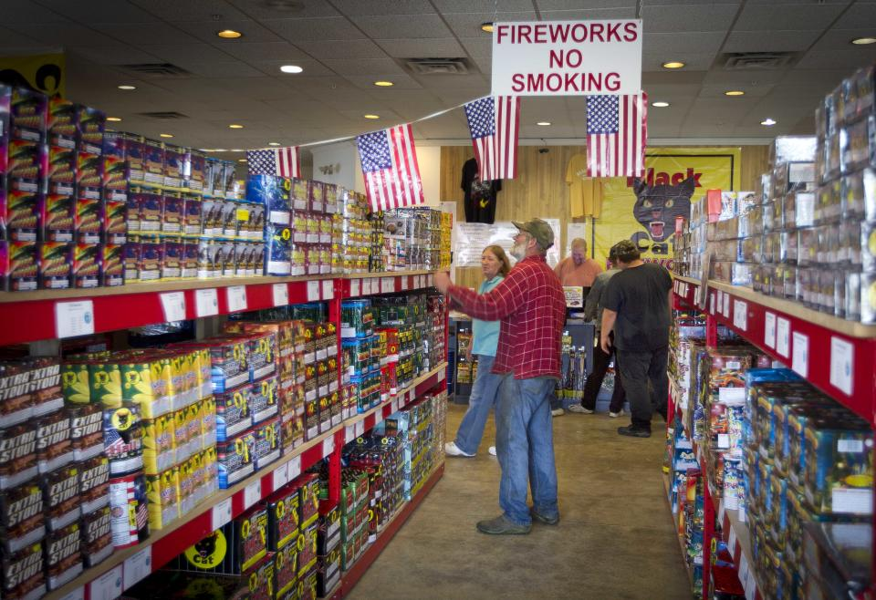 FILE - In this Friday, June, 28, 2013, file photo, people shop at Pyro City retail store, in Winslow, Maine. The government reports how much consumers spent and earned in June on Friday, Aug. 2, 2013. (AP Photo/Robert F. Bukaty, File)