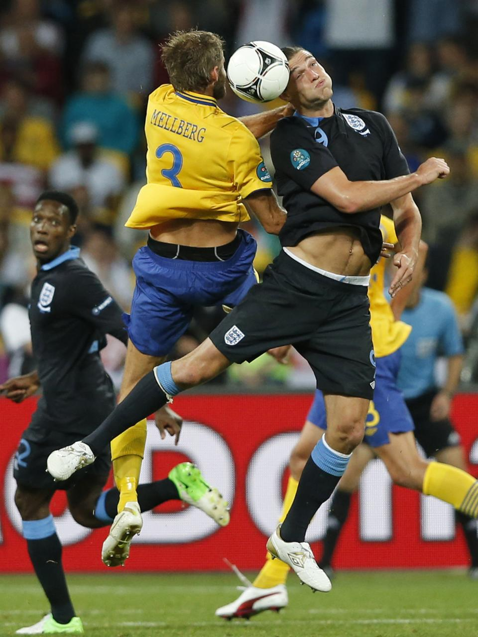 Sweden's Olof Mellberg, left, and England's Andy Carroll jump for the ball during the Euro 2012 soccer championship Group D match between Sweden and England in Kiev, Ukraine, Friday, June 15, 2012. (AP Photo/Sergei Grits)