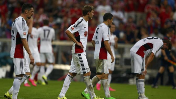 Bayer Leverkusen players leave the pitch following their defeat by Bayern Munich in their German first division Bundesliga soccer match in Munich