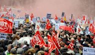 People attend a demonstration organised by Unions against financial cuts in health and education on April 29 in Madrid. Tens of thousands of people demonstrated across Spain against new austerity measures targetting education and health care spending