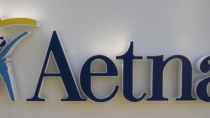 FILE - In this Feb. 9. 2006 file photo, a sign for the Aetna insurance is seen in a Hartford, Conn. Aetna said Tuesday July 31, 2012 its second-quarter net income tumbled almost 15 percent, as rising medical costs countered revenue gains.(AP Photo/Douglas Healey, file)
