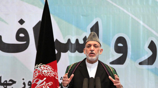 Afghanistan President Hamid Karzai speaks during an event marking last week's World Environment Day, in Kabul Afghanistan, Saturday, June 8, 2013. The annual World Environment Day is run by the United Nations Environment Program and is traditionally celebrated on June 5 to raise global awareness of the need to take positive environmental action. (AP Photo/Ahmad Jamshid)