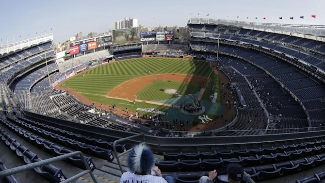 Fans seated in the upper deck at Yankee Stadium wait for the start of Game 2 of the American League championship series between the Yankees and Detroit Tigers Sunday, Oct. 14, 2012, in New York. (AP Photo/Charlie Riedel)