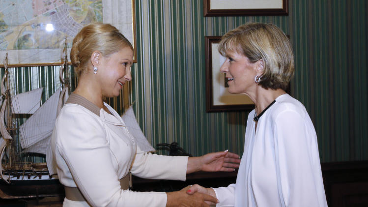 Former Ukrainian Prime Minister Yulia Tymoshenko, left, greets Australian Foreign Minister, Julie Bishop during their meting in Kiev, Ukraine, Wednesday July 30, 2014. (AP Photo/Olexander Prokopenko, pool)