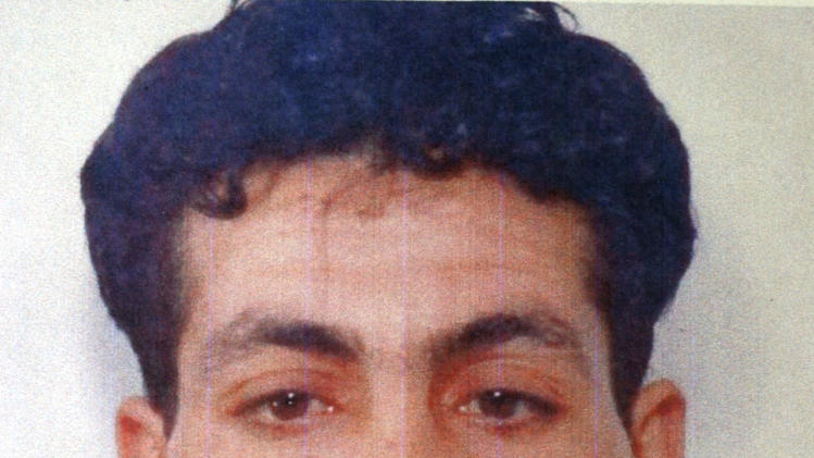FILE - This file photo released by Italian Police on May 18, 2005, shows Lazhar Ben Mohamed Tlil, a Tunisian who became an Islamic militant and was trained in Afghanistan to kill Americans, who entered the witness protection program after providing information to Italian investigators about several detainees at Guantanamo, his court-appointed lawyer, Davide Boschi, told The Associated Press. The lawyer has said that Tlil, considered an important witness by both Italians and Americans, would not talk to prosecutors without firm guarantees of a new identity, documents, a job, medical coverage and a visit to his parents in Tunisia. (AP Photo/Antonio Calanni)