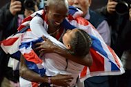 Britain&#39;s Mo Farah celebrates with his daughter Rihanna after winning the men&#39;s 10,000m final at the athletics event of the London 2012 Olympic Games