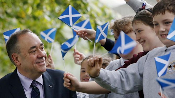 Scotland's First Minister Alex Salmond poses for photographs with school children after casting his ballot at Ritchie Hall in Strichen, Scotland, Thursday, Sept. 18, 2014. Polls opened across Scotland in a referendum that will decide whether the country leaves its 307-year-old union with England and becomes an independent state. (AP Photo/PA, Danny Lawson) UNITED KINGDOM OUT
