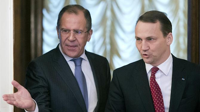 Russian Foreign Minister Sergey Lavrov, left, welcomes his Polish counterpart Radoslaw Sikorski for a meeting in Moscow, Russia, Monday, Dec. 17, 2012. (AP Photo/Misha Japaridze)