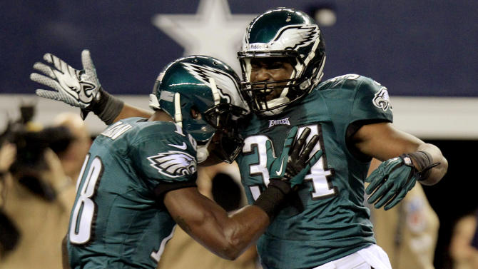 Philadelphia Eagles running back Bryce Brown (34) celebrates with Jeremy Maclin after scoring a touchdown against the Dallas Cowboys during the first half of an NFL football game, Sunday, Dec. 2, 2012, in Arlington, Texas. (AP Photo/LM Otero)