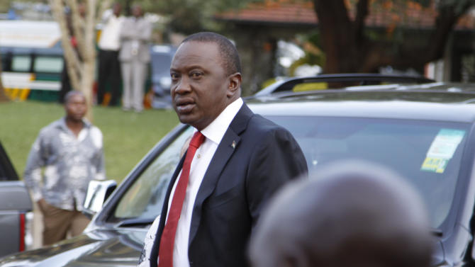 Presidential  candidate Uhuru Kenyatta arrives to take part in a televised debate between presidential contenders, in Nairobi, Kenya Monday, Feb. 11, 2013. Kenya's foreign affairs minister on Monday criticized European Union ambassadors in person for what he called an orchestrated attempt to favor a presidential candidate in Kenya's upcoming elections due to take place on March 4, in which one of the top contenders is Uhuru Kenyatta who faces charges before the International Criminal Court related to the postelection violence that killed more than 1,000 people after Kenya's last presidential election in 2007. (AP Photo/Khalil Senosi) ---------
