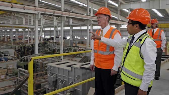 In this Aug. 29, 2013 photo provided by the Alabama Governor's office, Gov. Robert Bentley, left, listens to Roger Zhang, Golden Dragon U.S.A. President, during a tour of the new Golden Dragon copper tubing plant, then under construction, in Pine Hill, Ala. Golden Dragon, the first company Bentley recruited to Alabama after being elected, will employ 300 new full-time employees in rural Wilcox County. (AP Photo/Alabama Governor's Office, Jamie Martin)