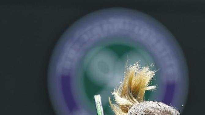 Camila Giorgi of Italy serves to Caroline Wozniacki of Denmark during their singles match at the All England Lawn Tennis Championships in Wimbledon, London, Saturday July 4, 2015. (AP Photo/Kirsty Wigglesworth)