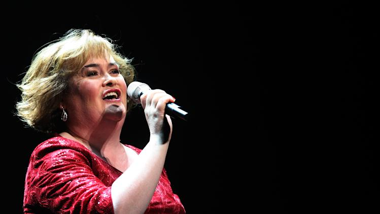 "In this Tuesday, March 27, 2012 file photo, Susan Boyle performs during her musical 'I Dreamed A Dream' at the Theatre Royal in Newcastle, England. But what happened next for Susan Boyle? The middle-aged church volunteer from a small town in Scotland became an instant global celebrity in 2009 with her heart-stopping rendition of the ""Les Miserables"" number ""I Dreamed a Dream"" on a TV talent show. A week is a long time in showbiz _ and in our hyper-speed online age three and a half years is an eternity _ but Boyle is still going strong. She has sold millions of records, received an honorary doctorate, sung for Pope Benedict XVI and performed in Las Vegas. A stage musical about her life has played to enthusiastic crowds across Britain and is headed for Australia, and next month she releases her fourth album, ""Standing Ovation."" (AP Photo/Scott Heppell, File)"
