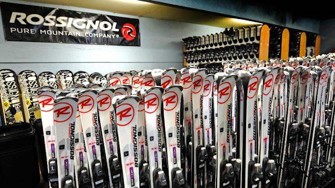 This January 2013 photo shows a display of skis for rent at the Ski & Ride Center at Schweitzer Mountain Resort in Sandpoint, Idaho. Some skiers see renting gear as a good alternative to bringing their own skis on a plane, partly because of airline baggage fees and partly because they can get the latest gear and skis for local conditions if they rent. (AP Photo/Schweitzer Mountain Resort)