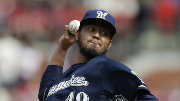 Milwaukee Brewers starting pitcher Yovani Gallardo throws during the first inning of a baseball game against the St. Louis Cardinals, Saturday, April 13, 2013, in St. Louis. (AP Photo/Jeff Roberson)